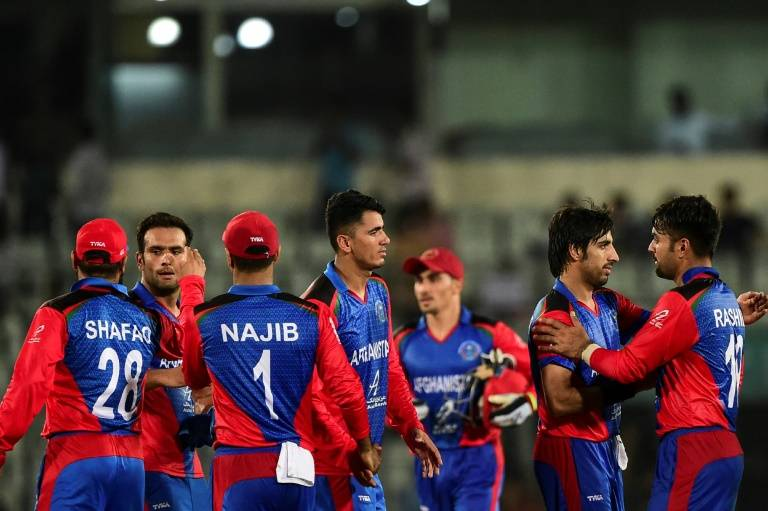 Afghanistan players celebrate after winning their second match against Bangladesh during the tri-nation Twenty20 international tournament in Dhaka on Sunday. — AFP
