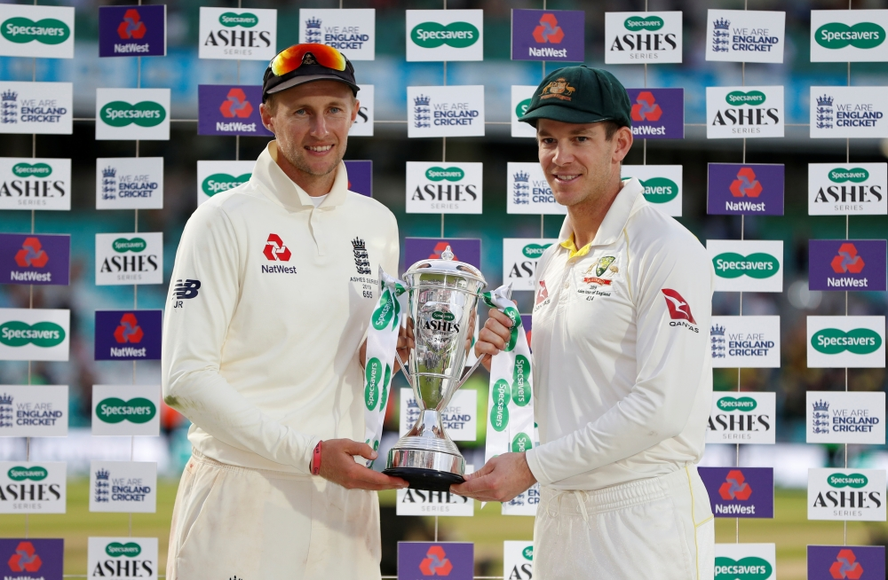 England's Joe Root and Australia's Tim Paine pose for a photo with the Ashes trophy after drawing the series at Kia Oval, London, Britain, on Sunday. — Reuters