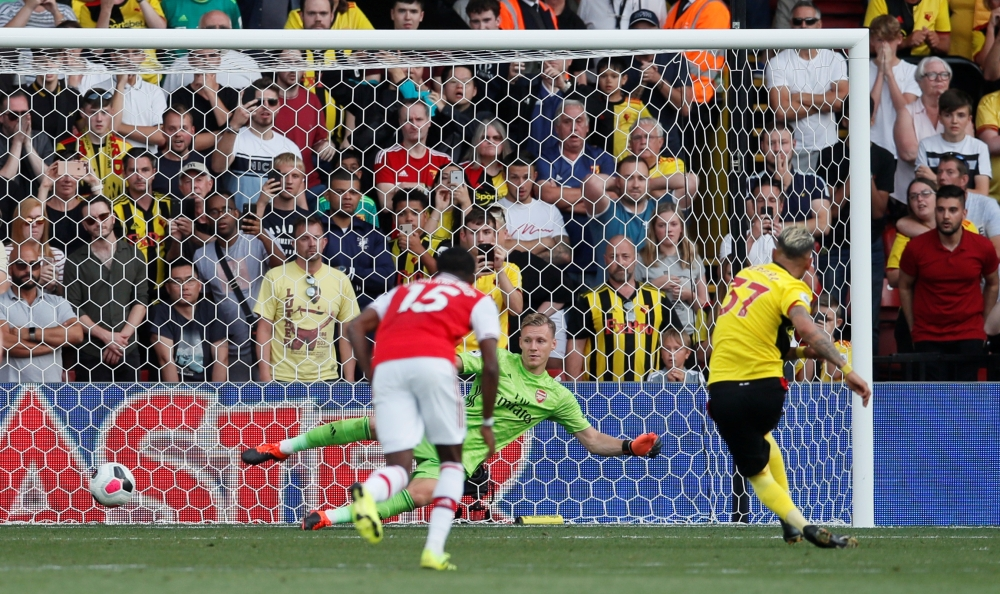 Watford's Roberto Pereyra scores their second goal from the penalty spot during the Watford vs Arsenal game at Vicarage Road, Watford, Britain, on Sunday. — Reuters
