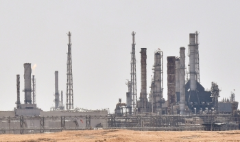 A picture taken on Sunday shows an Aramco oil facility near Al-Khurj area, just south of the Saudi capital Riyadh. Saudi Arabia raced today to restart operations at oil plants hit by drone attacks which slashed its production by half. — AFP