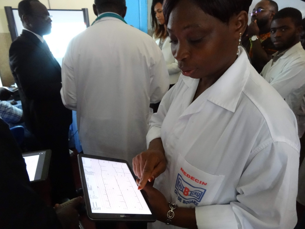 An Ivorian doctor uses a tablet computer in Bouake hospital's trailblazer telemedicine departement for heart diseases, in Bouake on June 20, 2019. -AFP