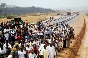 In this file photo taken on January 18, 1983, Gabonese take part in the inauguration of the second section of the Trans-Gabon Railway. -AFP