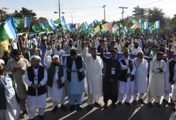 Activists of Jamaat-e-Islami Pakistan march as they shout anti-Indian slogans during a protestin the support of the citizens of Indian administered Kashmir in Quetta on Sunday. — AFP