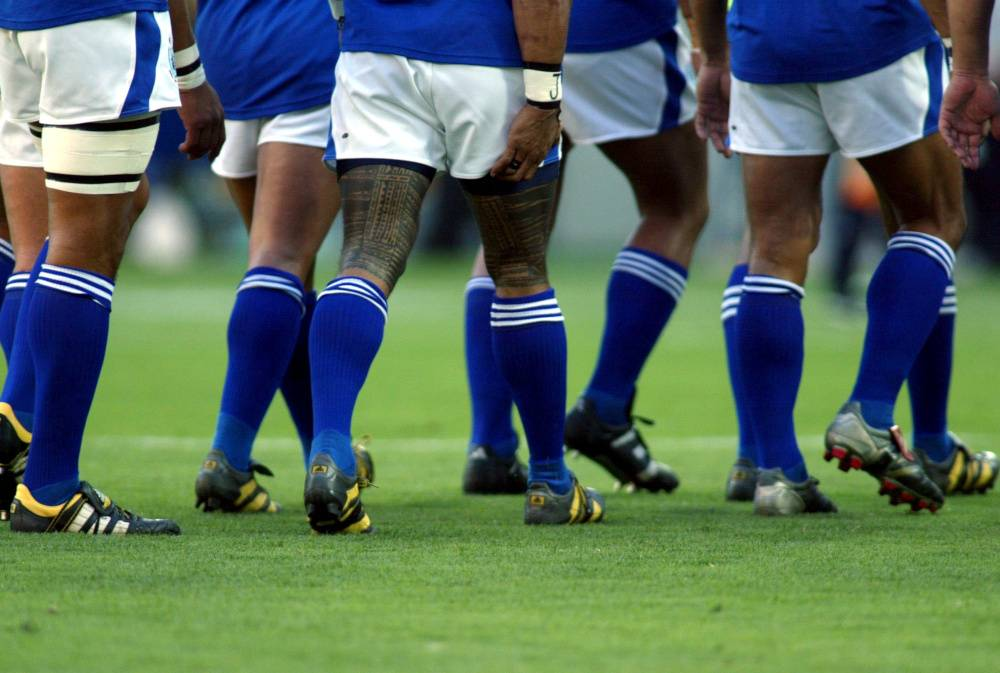 In this file photo taken on Nov. 1, 2003, the tattooed legs of Samoa's Lome Fa'atau during the Rugby World Cup 2003, South Africa vs Samoa in Brisbane, Australia. — Reuters