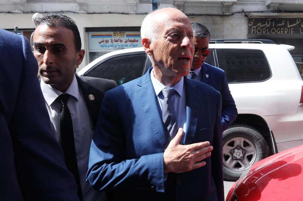 Presidential candidate Kais Saied arrives at his campaign headquarters, as the country awaits the official results of the presidential election in Tunis, Tunisia, on Tuesday. — Reuters