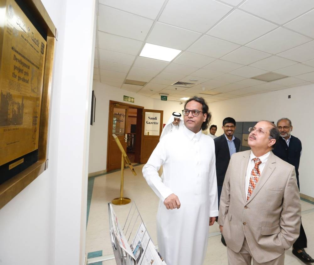 Indian Ambassador Dr. Ausaf Sayeed and Consul General Md. Noor Rahman Sheikh are shown the plaque of Saudi Gazette's first edition by Okaz Editor in Chief and General Supervisor of the Saudi Gazette Editorial Jameel Altheyabi.