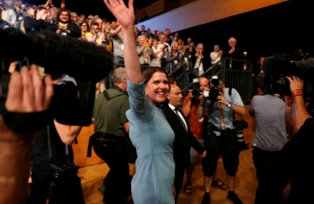 Leader of Britain's Liberal Democrats Jo Swinson leaves after she delivered her speech at the yearly party conference in Bournemouth, Britain, on Tuesday. — Reuters