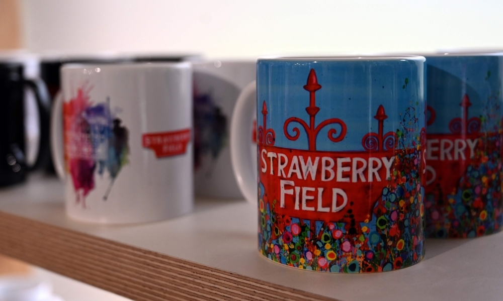 Strawberry Field branded memorabilia is pictured in the gift shop of the newly opened visitor attraction in Liverpool, northwest England on Wednesday. Beatles fans can now take a trip through the childhood sanctuary of John Lennon that inspired seminal song