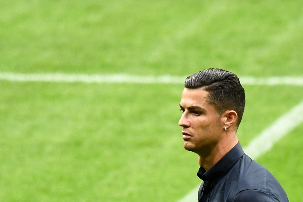 Juventus' Portuguese forward Cristiano Ronaldo walks around the Wanda Metropolitano stadium in Madrid on Tuesday on the eve of the UEFA Champions League Group D football match against Atletico de Madrid. — AFP