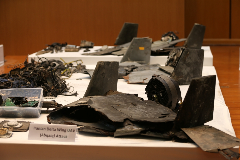 Remains of the missiles which Saudi government says were used to attack an Aramco oil facility, are displayed during a news conference in Riyadh, Saudi Arabia, on Wednesday. — Reuters