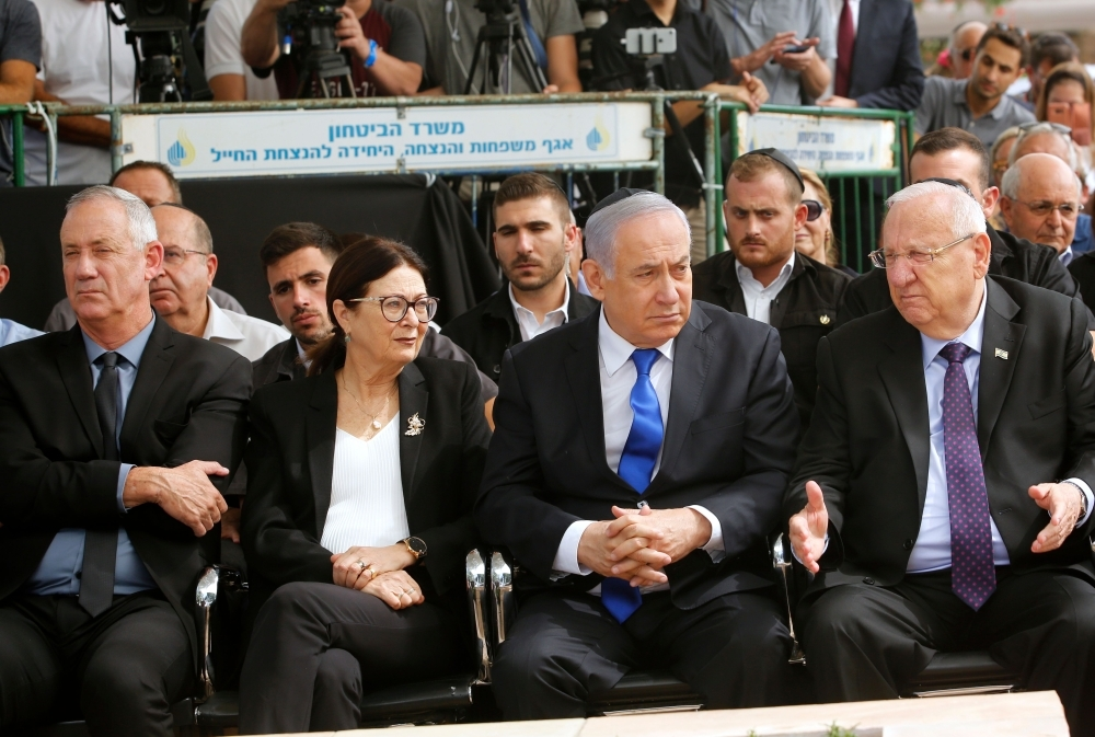 From R to L: Israeli President Reuven Rivlin, Prime Minister Benjamin Netanyahu, Israeli president of the Supreme Court Esther Hayut and Benny Gantz, leader of Blue and White party, attend a memorial ceremony for late Israeli president Shimon Peres, at Mount Herzl in Jerusalem on Thursday. Netanyahu called on his main challenger Benny Gantz to form a unity government together, a major development after deadlocked election results put his long tenure in office at risk. — AFP