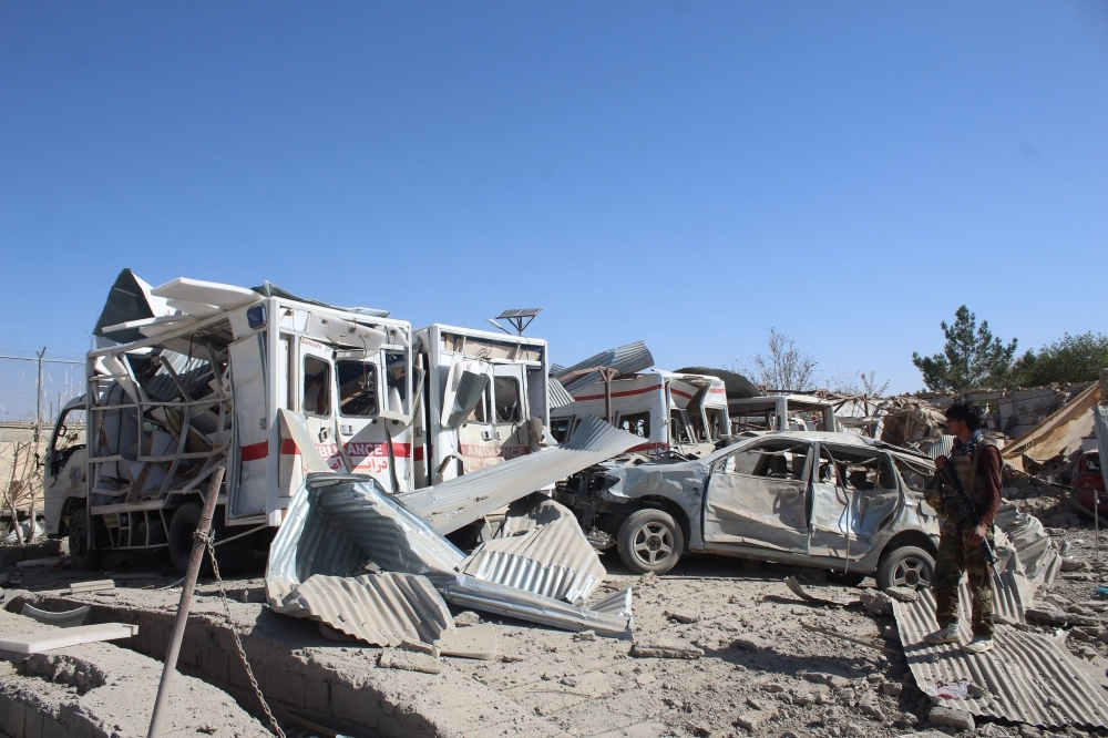 Afghan security forces investigate the site where a Taliban car bomb detonated near an intelligence services building in Qalat in Zabul province on Thursday. A car bomb attack targeting an intelligence services building in the southern Afghan city of Qalat left at least 10 people dead and 85 wounded, the governor of Zabul province said. — AFP