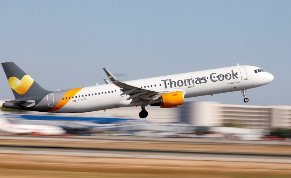 A Thomas Cook Airbus A321-200 airplane takes off at the airport in Palma de Mallorca, Spain, in this July 28, 2018, file photo. — Reuters