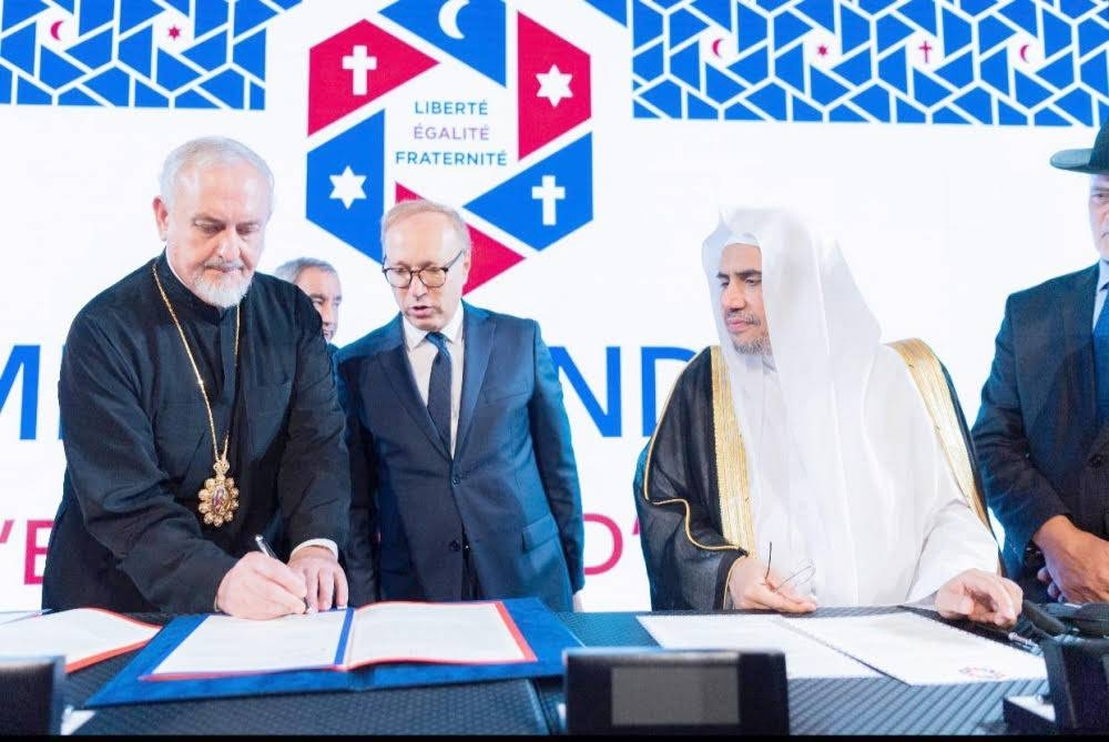 Muhammad Al-Issa, secretary general of MWL, with leaders of the Abrahamic Family while signing the Paris Agreement on Thursday. — SPA