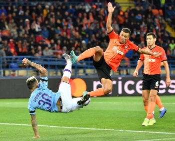 Manchester City's Argentinian defender Nicolas Otamendi and Shakhtar Donetsk's Ukrainian forward Junior Moraes vie for the ball during the UEFA Champions League Group C football match at the OSK Metalist stadium in Kharkiv on Wednesday. — AFP