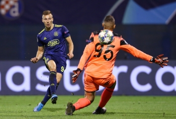 GNK Dinamo Zagreb's Mislav Orsic scores their fourth goal to complete his hat-trick against Atalanta during the Champions League  Group C match at the Stadion Maksimir, Zagreb, Croatia, on Wednesday. — Reuters
