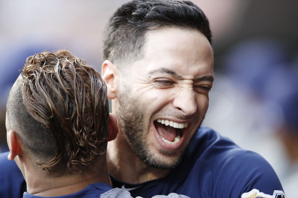 Braun hits grand slam as Brewers secure playoff spot