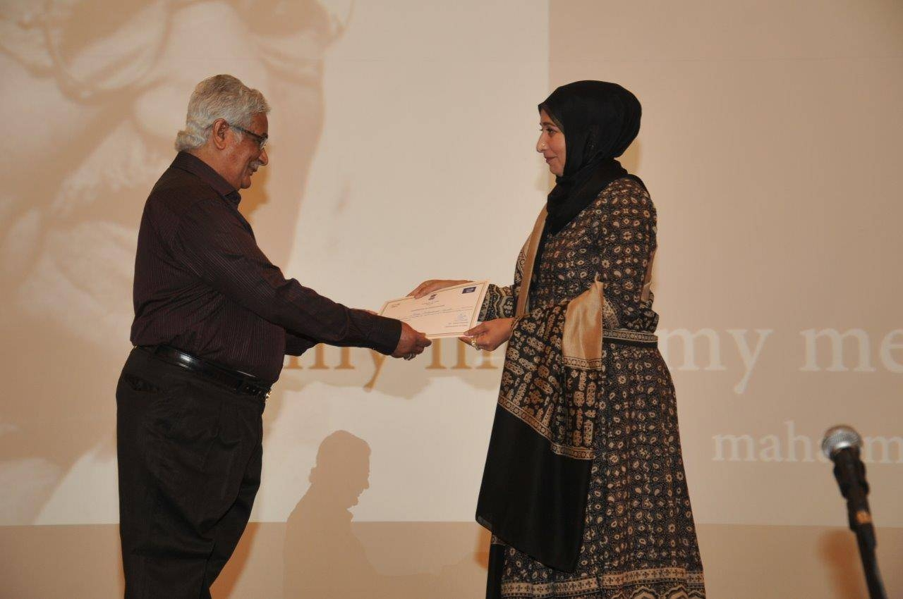 N.A. Mirza receiving certificate of participation from Mrs. Ausaf Sayeed.