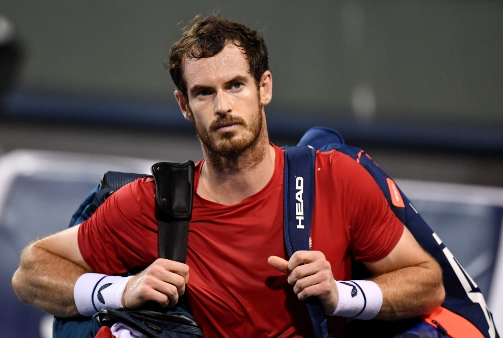 Andy Murray of Britain leaves the court after losing against Fabio Fognini of Italy in their men's singles match at the Shanghai Masters tennis tournament in Shanghai on Tuesday. — AFP