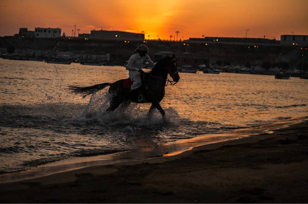 A horseman in Al-Wajh governorate pursuing his hobby of horse riding on the beach. — SPA