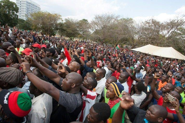 Malawi opposition supporters march to the parliament during a demonstration against the re-election of the president, which protestors say was due to fraud, on July 4, 2019, in Lilongwe, Malawi -AFP