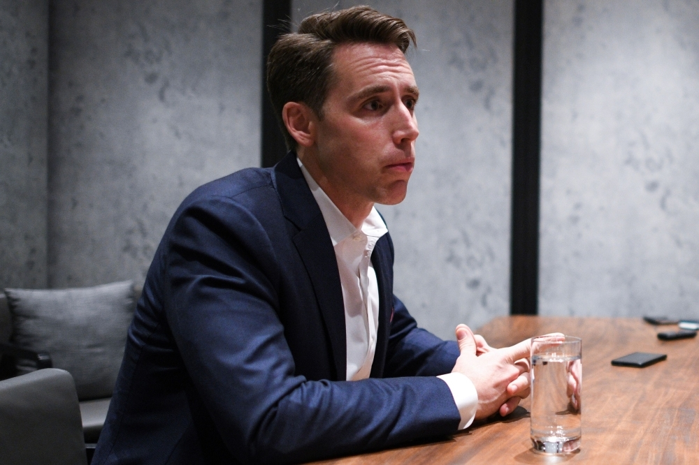 US Republican Senator from Missouri Josh Hawley listens to questions from members of the media at a hotel in Hong Kong on Monday.  -AFP