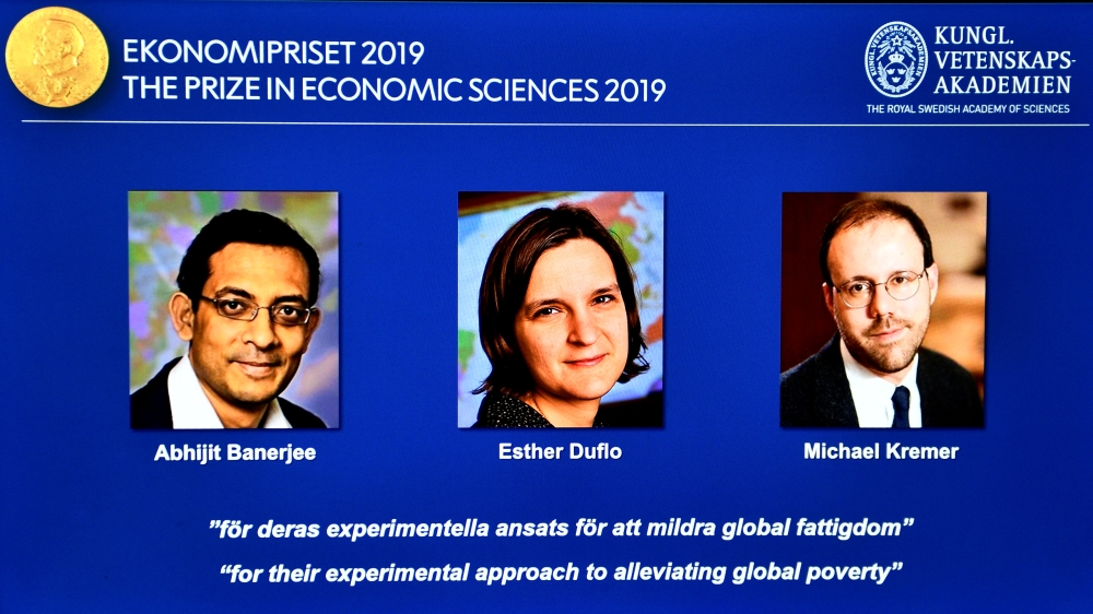 The portraits of Abhijit Banerjee, right, Esther Duflo, center, and Michael Kreme, who have been announced the Nobel Prize in Economic Sciences 2019 winners, are seen at a news conference at the Royal Swedish Academy of Sciences in Stockholm, Sweden, on Monday. — Reuters