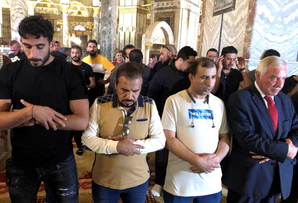 Saudi Arabia's national soccer team members pray in Al-Aqsa Mosque in Jerusalem, on Monday. — Reuters