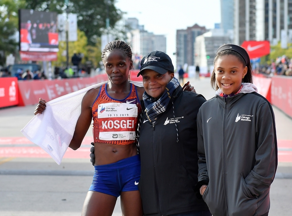 Brigid Kosgei of Kenya poses with Chicago mayor Lori Lightfoot after breaking the world record to win the 2019 Bank of America Chicago Marathon in Chicago, Illinois, on Sunday. — AFP