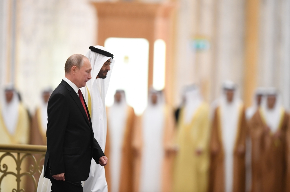Russian President Vladimir Putin, right, is received by Abu Dhabi's Crown Prince Mohammed Bin Zayed during an official welcoming in the Emirati capital's Al-Watan presidential palace on Tuesday. — AFP
