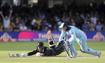 England's Jos Buttler runs out New Zealand's Martin Guptill to win 2019 Cricket World Cup final following a Super Over. — AFP