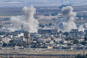 Smoke rising from the Syrian town of Ras Al-Ain, from the Turkish side of the border at Ceylanpinar district in Sanliurfa, is seen on the first week of Turkey's military operation against Syrian Kurdish fighters, on Tuesday. — AFP