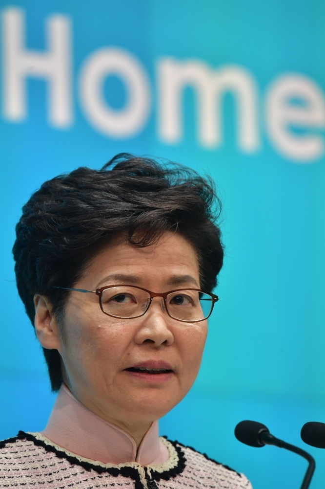 Hong Kong's Chief Executive Carrie Lam speaks at a press conference in Hong Kong on Wednesday, after she tried twice to begin her annual policy address inside the city's legislature. -AFP