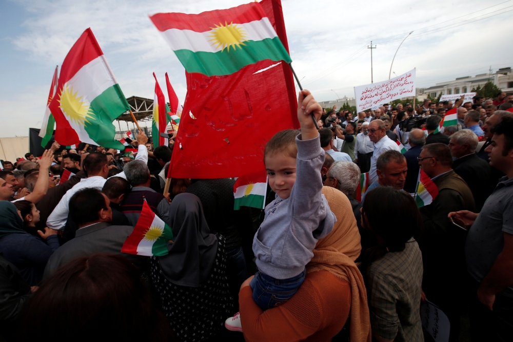 Iraqi Kurds protest the Turkish offensive against Syria during a demonstration outside the United Nations building in Irbil, Iraq, in this Oct. 12, 2019 file photo. — Reuters