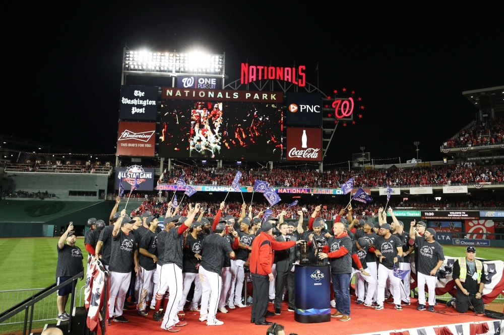 The Washington Nationals celebrate winning game four and the National League Championship Series against the St. Louis Cardinals at Nationals Park on in Washington, DC, on Tuesday. — AFP