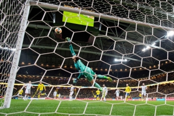 Spain's goalkeeper David de Gea makes a save during the Euro 2020 Group F qualification football match between Sweden and Spain at Friends Arena in Stockholm, on Tuesday. — AFP