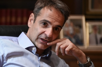 Greek Prime Minister Kyriakos Mitsotakis gives an interview journalists in Athens on Tuesday. — AFP