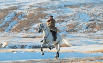 This undated picture released by Korean Central News Agency on Wednesday shows North Korean leader Kim Jong Un riding a white horse amid the first snow at Mount Paektu. — AFP