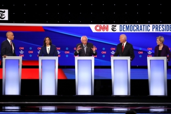 Sen. Cory Booker (D-NJ), left, Sen. Kamala Harris (D-CA), second left, Sen. Bernie Sanders (I-VT), center, former Vice President Joe Biden, second right, and Sen. Elizabeth Warren (D-MA), right, interact during the Democratic Presidential Debate at Otterbein University in Westerville, Ohio, on Tuesday. — AFP