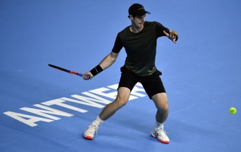 British Andy Murray  returns a shot during the Men's singles first round match against Kimmer Coppejans of Belgium, at the European Open ATP Antwerp tennis tournament in Antwerp, on Wednesday. — AFP
