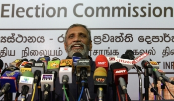 Sri Lanka's independent Election Commission Chairman Mahinda Deshapriya takes part in a press conference in Colombo on Wednesday. — AFP