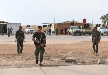 Syrian government forces gather at Tabqa air base in the northern Raqqa region on Wednesday. — AFP