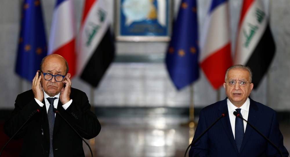 French Foreign Minister Jean-Yves Le Drian speaks during a news conference with Iraqi Foreign Minister Mohamed Ali Alhakim at the Ministry of Foreign Affairs in Baghdad, Iraq, on Thursday. — Reuters