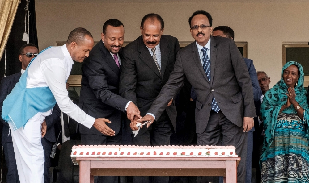 Eritrea's President Isaias Afwerki, second right, Ethiopia's Prime Minister Abiy Ahmed, second left, and Somalia's President Mohamed Abdullahi Mohamed, right, cut a ceremonial cake together during the inauguration of the Tibebe Ghion Specialized Hospital in Bahir Dar, northern Ethiopia, in this Nov. 10, 2018 file photo. — AFP