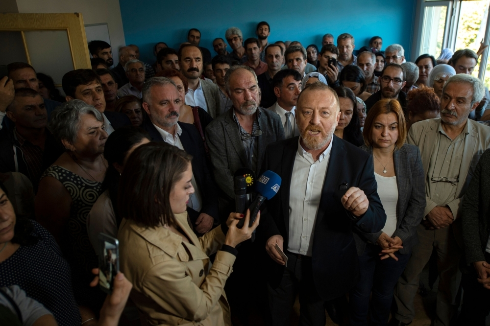 Co-leader of pro-Kurdish Peoples' Democratic Party (HDP) Sezai Temelli, center, gives a press conference on Turkish military operation in Syria, in Istanbul, in this Oct. 13, 2019 file photo. — AFP