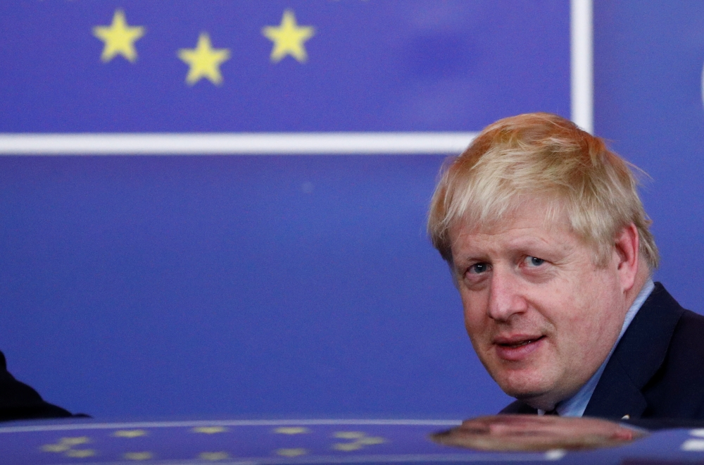 Britain's Prime Minister Boris Johnson leaves the European Council after the Brexit-dominated European Union leaders summit in Brussels, Belgium, on Friday. — Reuters