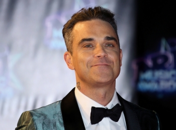 Singer Robbie Williams arrives to attend the NRJ Music Awards ceremony at the Festival Palace in Cannes, France, in this Nov. 12, 2016 file photo. — Reuters