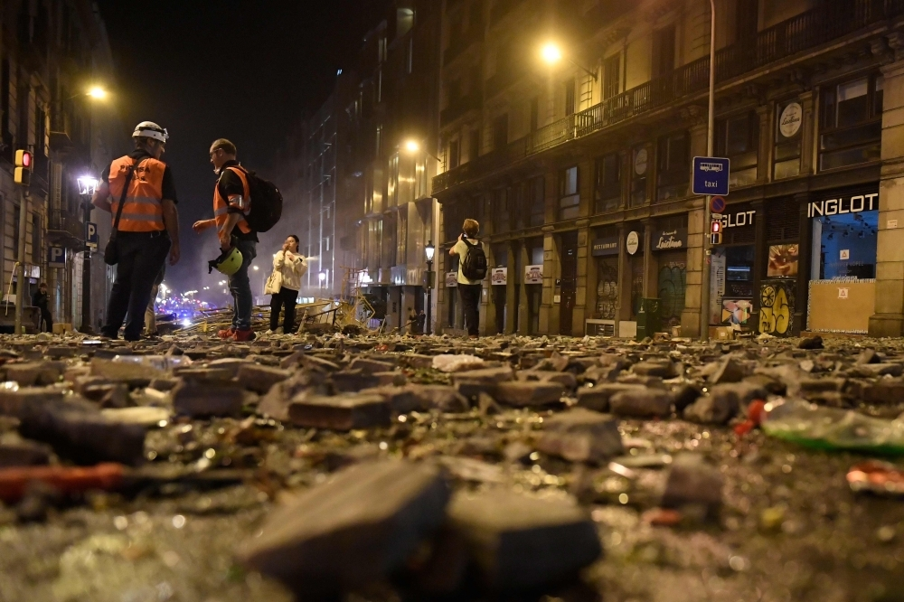 Debris are pictured on a street of Barcelona after violence escalated on Friday evening during clashes with radical separatists. — AFP