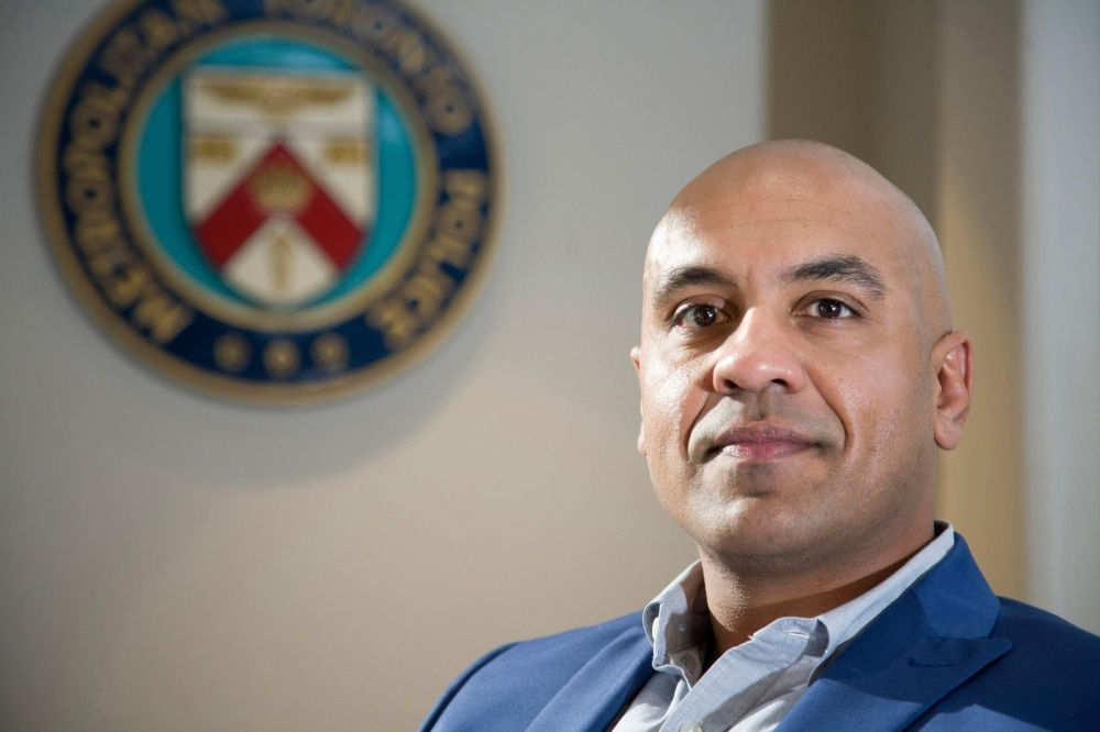 Toronto Police Constable Ron Chhinzer poses for a photo after an interview at the Toronto Police Service 23 Division, in Toronto on Oct. 15, 2019. Long associated with gang violence, the Regent Park neighborhood of Toronto — Canada's largest city — has changed. But firearms continue to claim casualties, prompting calls ahead of national elections on Oct. 21 for tougher gun controls. Ron Chhinzer, a detective in the Toronto Police Gang Prevention Unit, is concerned about the age of those involved in the violence. — AFP