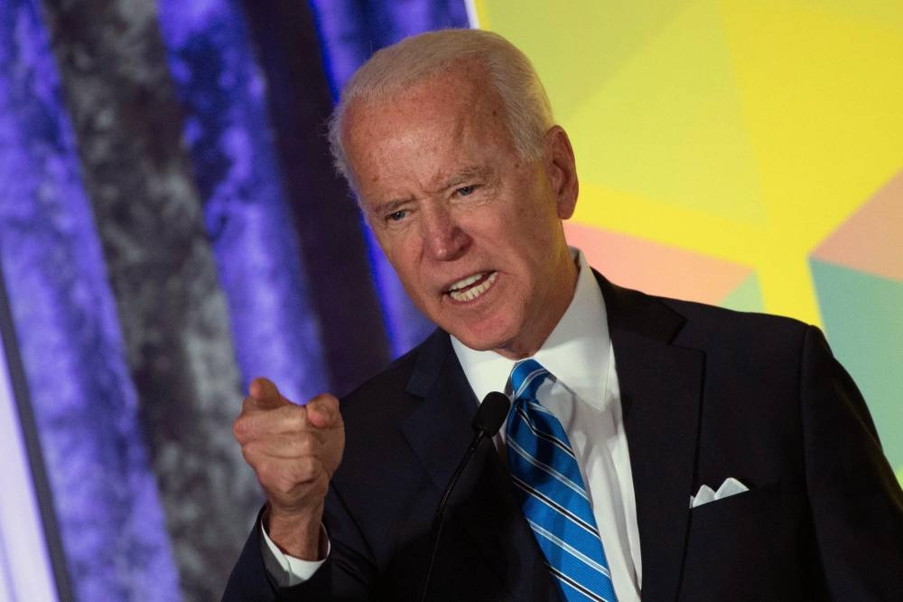 2020 Democratic presidential hopeful former US Vice President Joe Biden gestures as he speaks during the Women's Leadership Forum Conference on Oct. 17, 2019 in Washington DC. — AFP